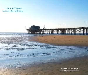 Photograph of Newport Pier and a sandbar by M. Caulder.