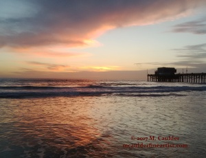 Photograph of Newport Beach at sunset by M. Caulder.